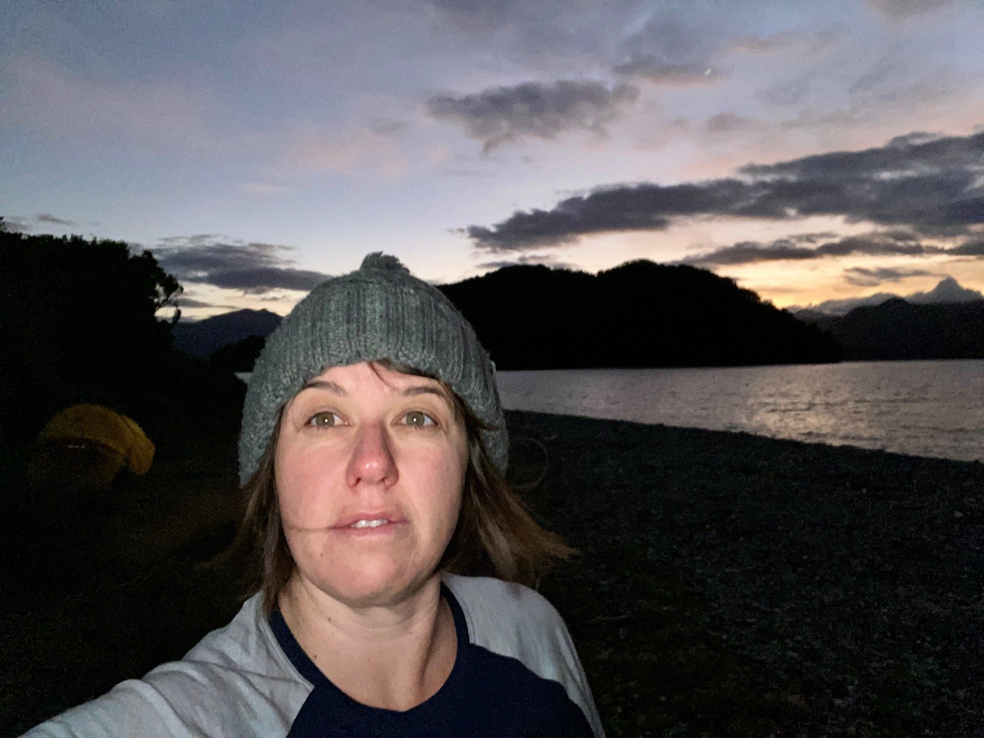 Kate Norris on remote island at sunset