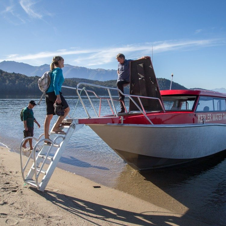 Meet the water taxi on the sandy shores of Brod Bay to complete your hike