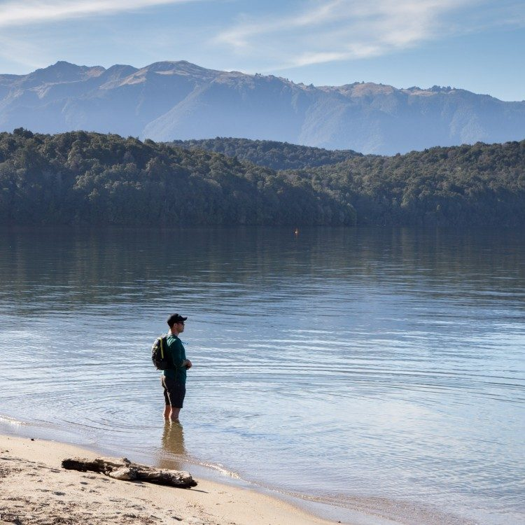 Splash in the cool waters of Lake Te Anau to soothe any aching feet at the end of your hike