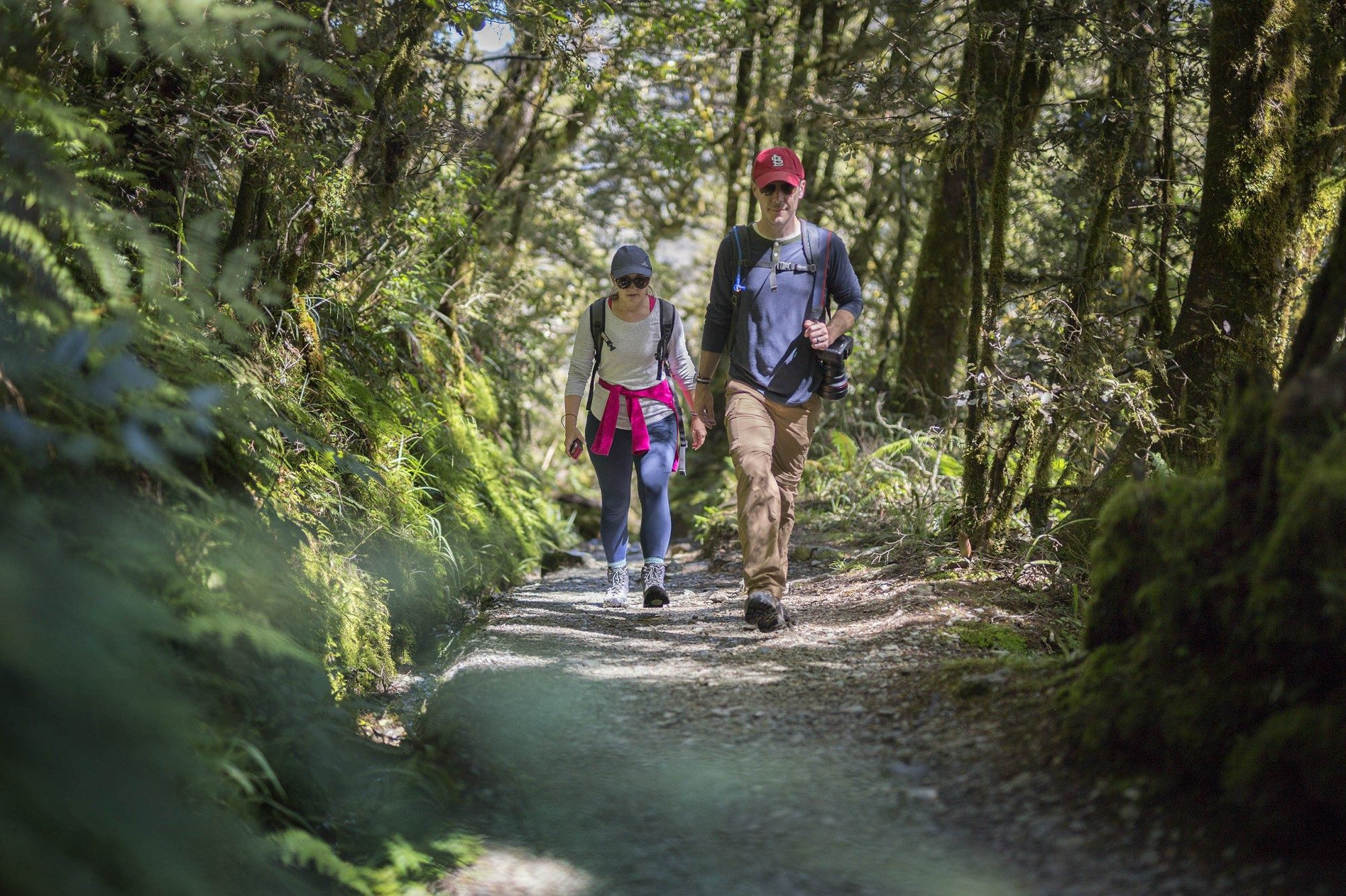 two hikers on the Routeburn trail walking uphill