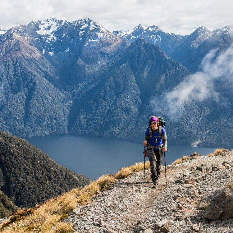 Heading toward the summit of Mt. Luxmore, Lake Te Anau and Murchison Mountains behind