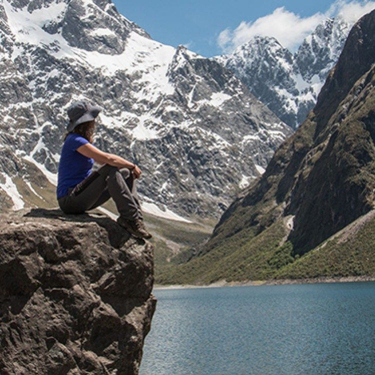 Take in the breath taking views of Lake Marian on one of the large rocks