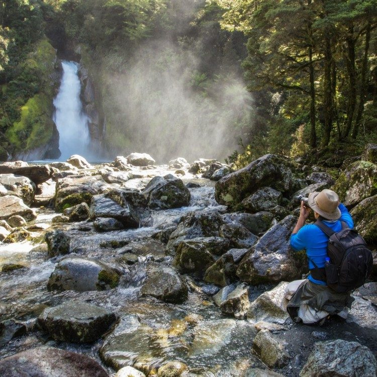 Photographer capturing Giant Gate Fall on Milford Track