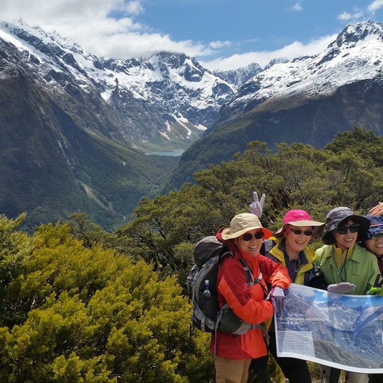 Celebrating at the top of Key Summit on the Routeburn Track with a photo