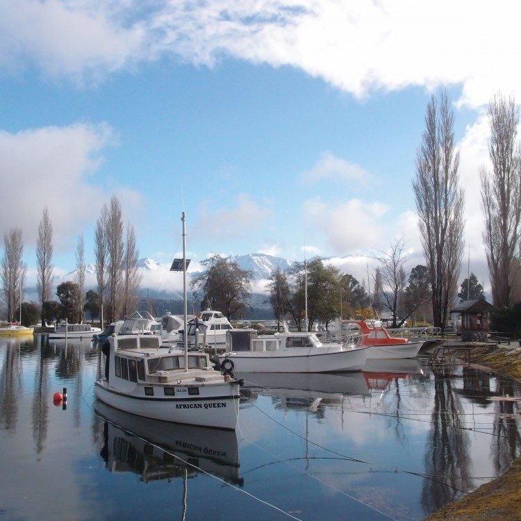 Stroll along the Te Anau lakefront to the boat harbor