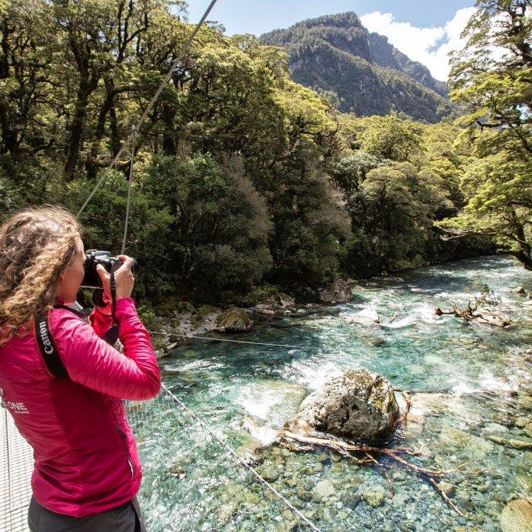 We begin our hike to Lake Marian crossing a swing bridge over the Hollyford River